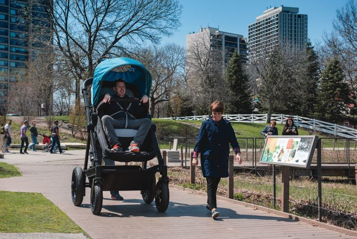 Parents in Chicago test out an adult-sized stroller to see what their kids are getting into.