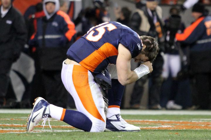 "Tim Tebow ""tebowing"" after a Denver Broncos game in 2012."