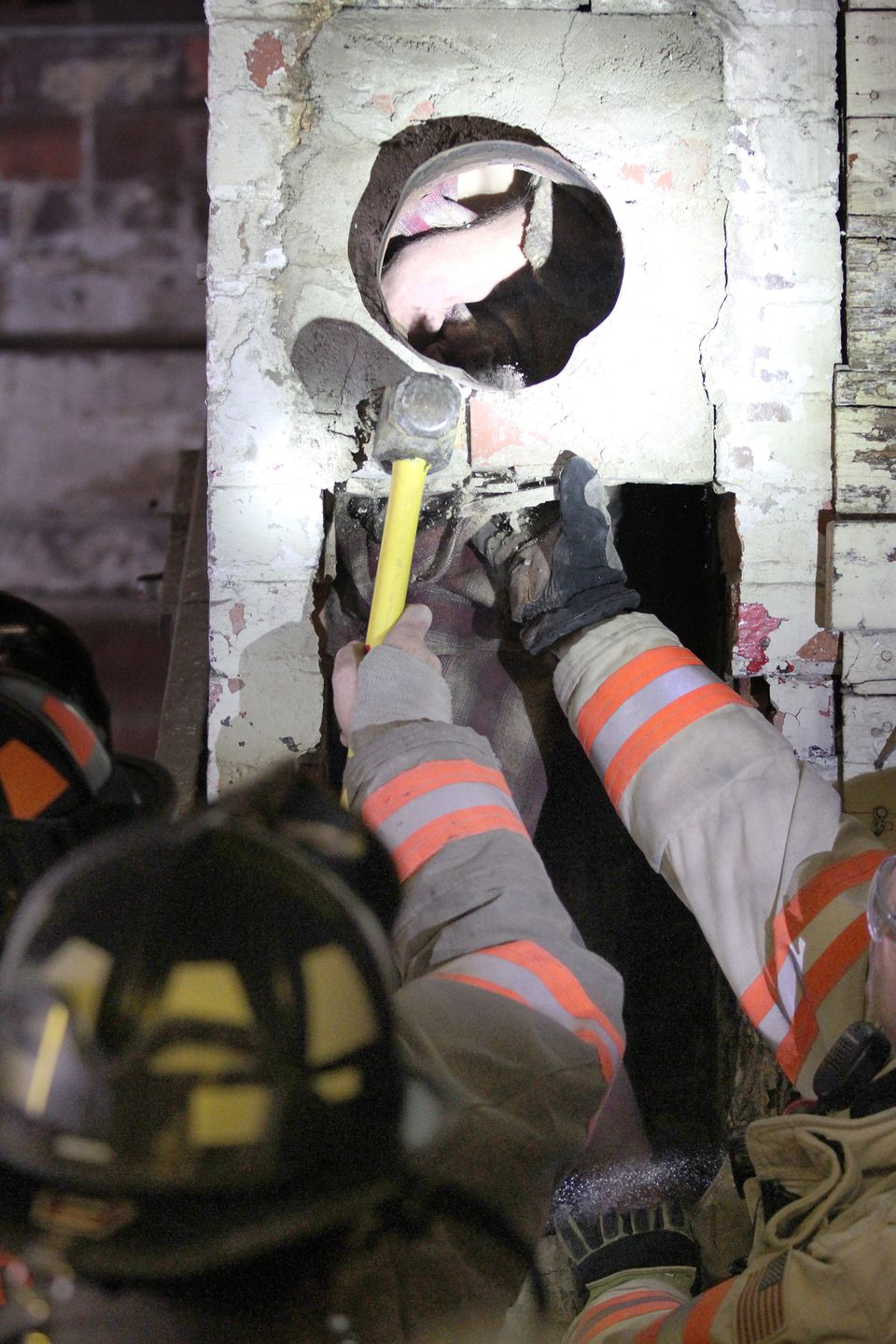 Firefighters free a man stuck inside a chimney at a redemption center in Carroll, Iowa.