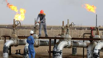 Iraqi labourers work at an oil refinery in the southern town Nasiriyah on October 30, 2015. South Oil Company (SOC) has raised production at Nasiriyah oil field from 40,000 barrels per day to between 65,000 and 70,000 barrels as it aims to reach 100,000 barrels by the end of next month.  AFP PHOTO / HAIDAR MOHAMMED ALI        (Photo credit should read HAIDAR MOHAMMED ALI/AFP/Getty Images)