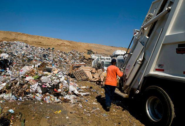 Crews unload trash at the Miramar Landfill in San Diego,