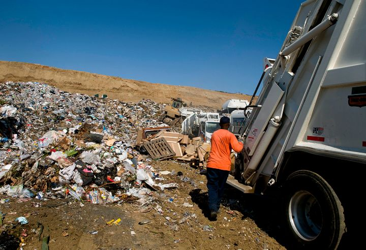 Crews unload trash at the Miramar Landfill in San Diego, California,