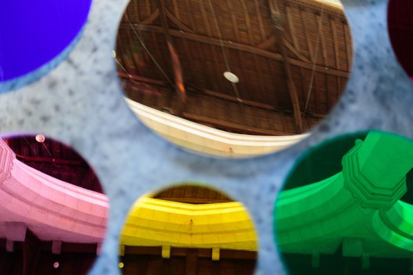 Colored, acrylic mirrors reflect the walls, ceiling and nave of the former St John's Church.