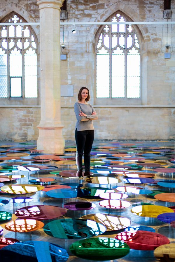 """Liz West stands at the center of her """"Our Colour Reflection"""" installation."""