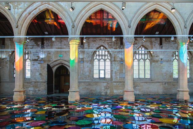 The installation relies on natural light, which dances across the walls in different colors and patterns depending on the tim