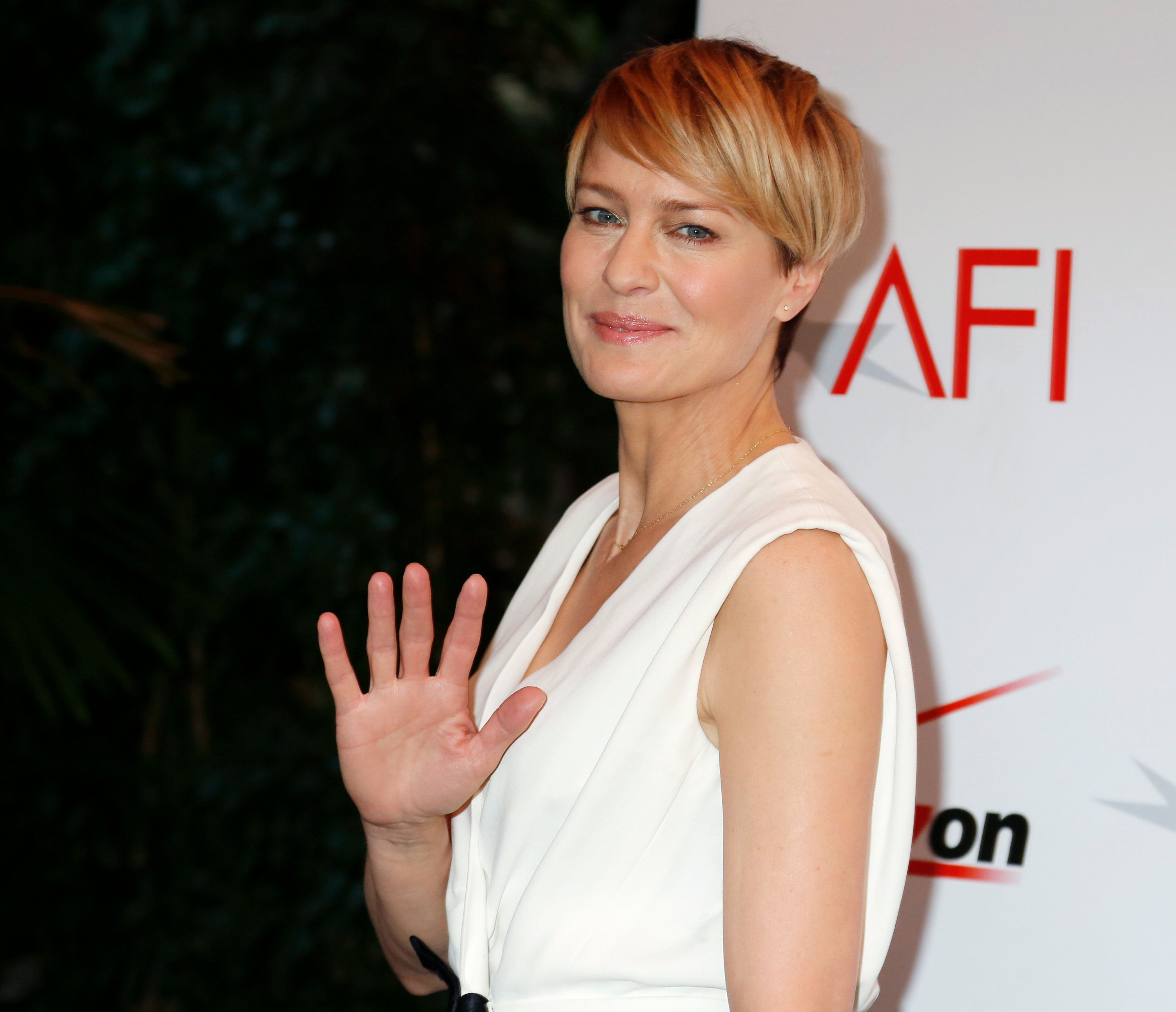 "Actress Robin Wright from the Netflix series ""House of Cards"" arrives at the AFI Awards 2013 honoring excellence in film and television in Beverly Hills, California January 10, 2014.  REUTERS/Fred Prouser (UNITED STATES - Tags: ENTERTAINMENT)"