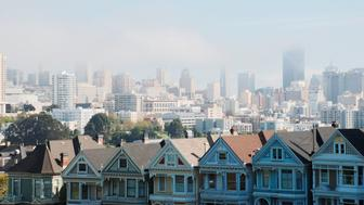 the view of downtown of San Francisco from the famous Alamo square.