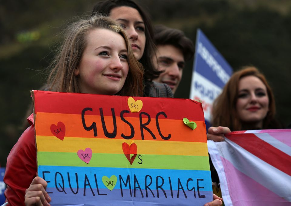 Students campaign outside Holyrood in Edinburgh on the day MSPs met to vote on whether to legalise same-sex