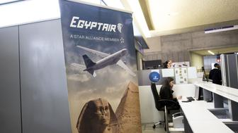 An employee sits at an EgyptAir Airlines ticket office at Charles de Gaulle airport, operated by Aeroports de Paris, in Roissy, France, on Thursday, May 19, 2016. Egypt deployed naval ships to search for an EgyptAir Airbus A320 en route to Cairo from Paris that went missing overnight off the coast of the North African country with 66 people on board. Photographer: Christophe Morin/Bloomberg via Getty Images