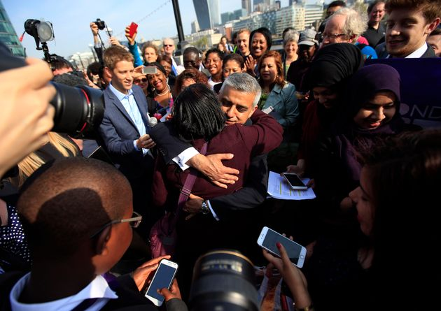 Sadiq Khan being mobbed by well-wishers on his first day in