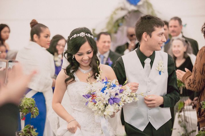 Krystel and Earle walk down the aisle after exchanging vows.