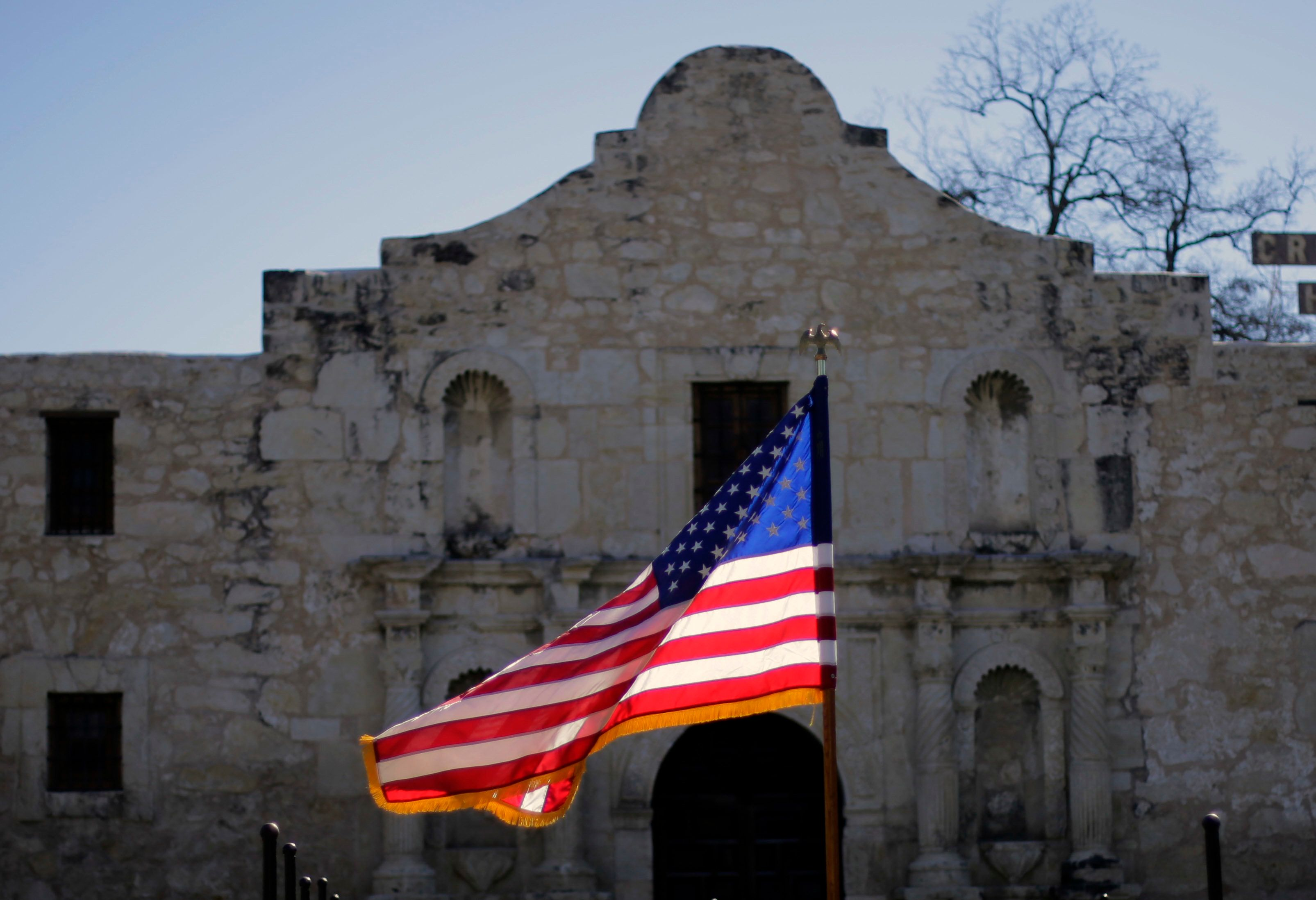 "The U.S. flag waves in front of the Alamo during a reenactment of the delivery of William B. Travis' ""Victory or Death"" letter, Wednesday, Feb. 24, 2016, in San Antonio. The Alamo is commemorating the 180th anniversary of the siege and battle of the Alamo. (AP Photo/Eric Gay)"