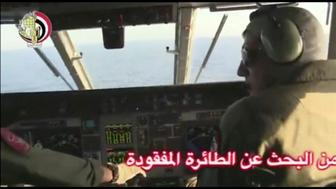 Pilots of an Egyptian military plane take part in a search operation for the EgyptAir plane that disappeared in the Mediterranean Sea in this still image taken from video May 19, 2016.  Egyptian Military/Handout via Reuters TV  ATTENTION EDITORS - THIS IMAGE WAS PROVIDED BY A THIRD PARTY. EDITORIAL USE ONLY. NO RESALES. NO ARCHIVE.