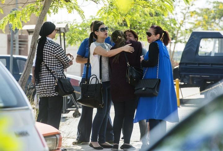 Families of passengers who were flying on board the missing EgyptAir plane wait for news outside a services hall at Cairo int