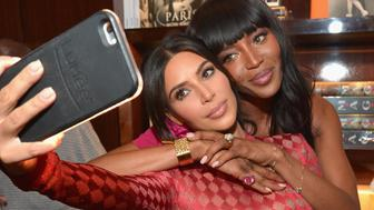 BEVERLY HILLS, CA - APRIL 28:  TV personality Kim Kardashian and model Naomi Campbell take a selfie during the Los Angeles launch of 'Naomi' at Taschen Beverly Hills on April 28, 2016 in Beverly Hills, California.  (Photo by Charley Gallay/Getty Images for Taschen)