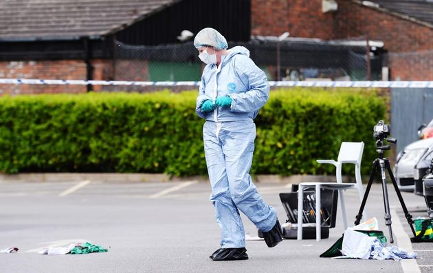 A forensics officer examines evidence at the