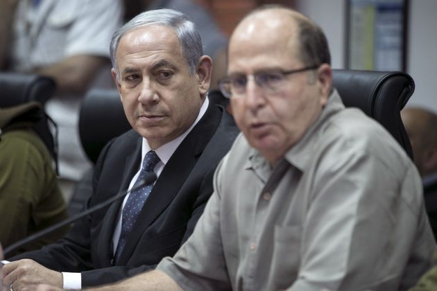 Israel's Prime Minister Benjamin Netanyahu (L) and Defence Minister Moshe Yaalon attend a briefing at...