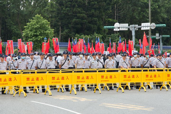 Police in Taipei stand guard at Tsai's inauguration. Tsai also proposed that Taiwan and China set aside disputes over control