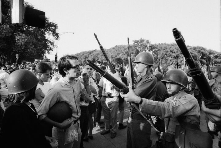 Protesters face off with armed National Guardsmen in Chicago during the 1968 Democratic National Convention.