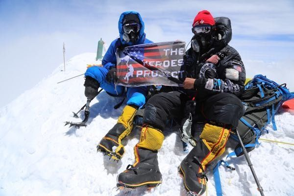 Marine Corps veteran Charlie Linville (left) and The Heroes Project founder and expedition leader Tim Medvetz pictured atop M