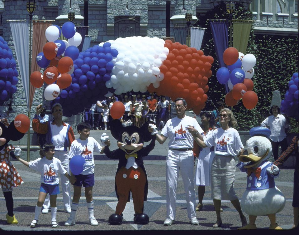 Mickey Mouse (C) and Donald Duck (R) during Hands Across America; Disneyland.