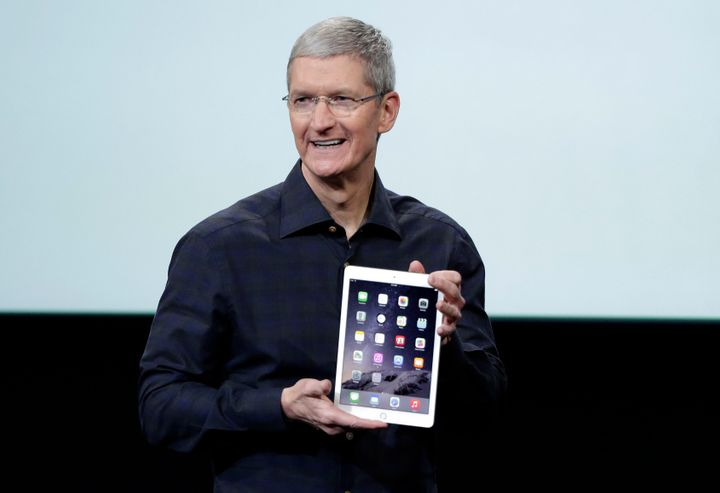 Apple CEO Tim Cook holds an iPad Air 2.