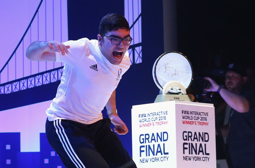 Mohamad Al-Bacha of Denmark, above, faced off against Sean Allen of Englandinthe FIFA Interactive World Cup Final
