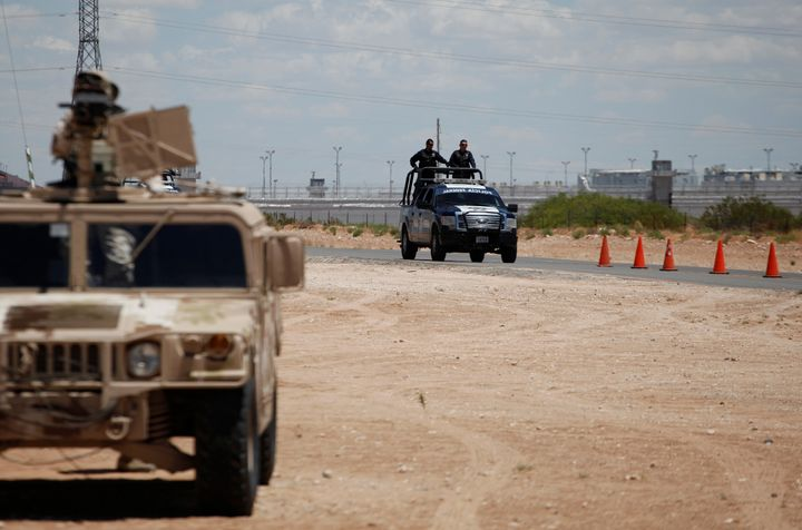 Federal forces keep watch on the perimeter of a high security prison where El Chapo is imprisoned in Ciudad Juarez, Mexico on