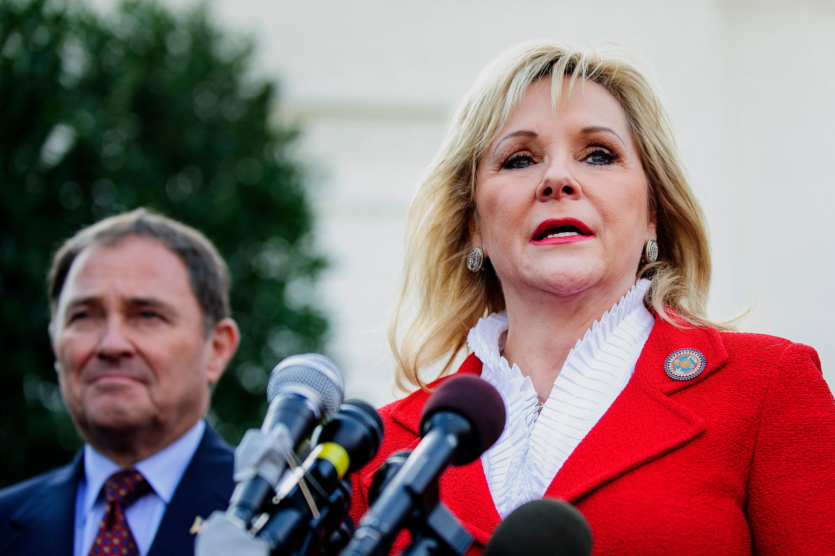 Republican Mary Fallin, governor of Oklahoma, right, speaks while while Republican Gary Herbert, governor of Utah, listens during a press conference after meeting with U.S. President Barack Obama in Washington, D.C., U.S., on Tuesday, Dec. 4, 2012. Negotiations over the so-called fiscal cliff are stalled as President Obama and Republicans trade offers on ways to avoid more than $600 billion in U.S. spending cuts and tax increases for 2013 that will start to take effect in January if Congress doesn't act. Photographer: Andrew Harrer/Bloomberg via Getty Images