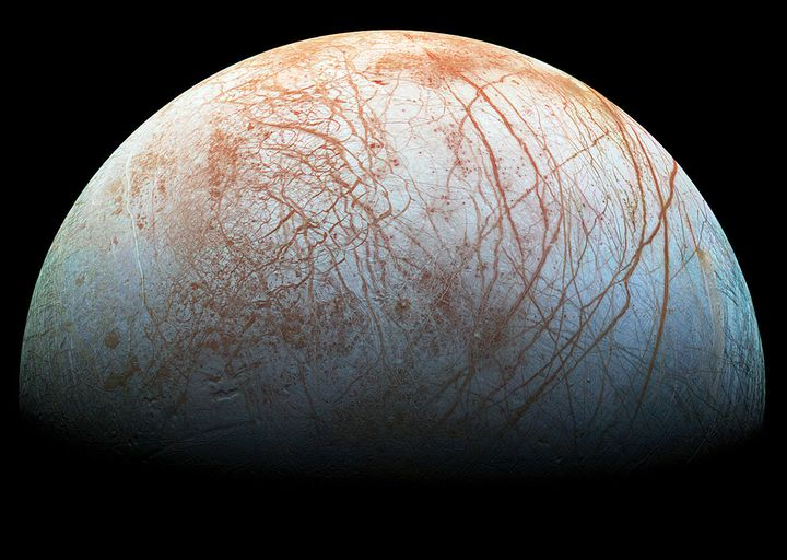 The puzzling, fascinating surface of Jupiter's icy moon Europa looms large in this image taken by NASA's Galileo spacecraft i