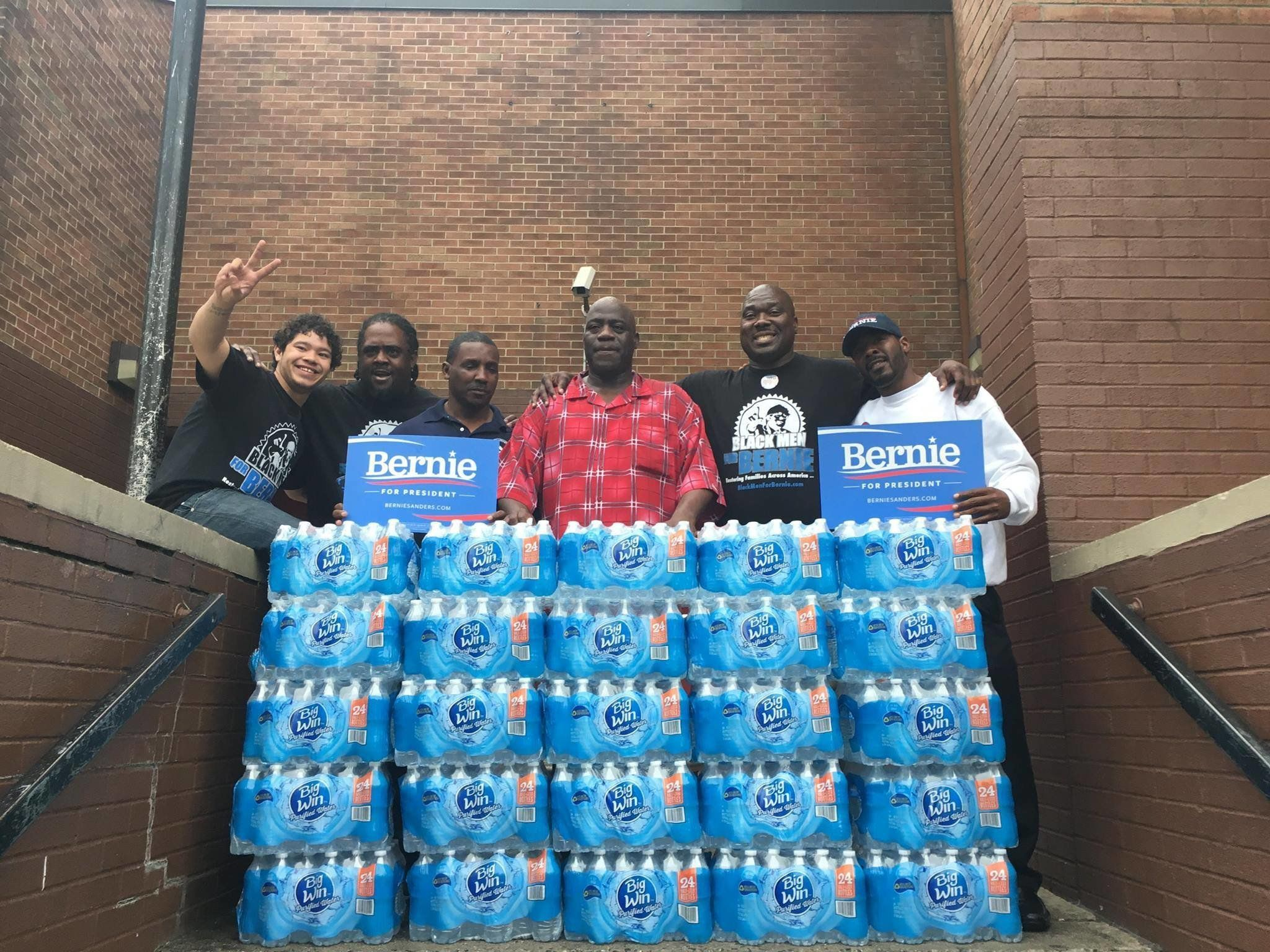 A group of black Bernie supporters went to Newark schools to distribute bottled water, after the schools' water supplies had been contaminated with lead.