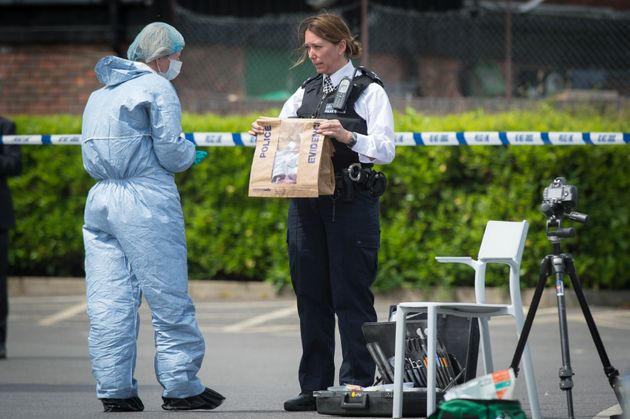 Police and forensic officers at the scene in