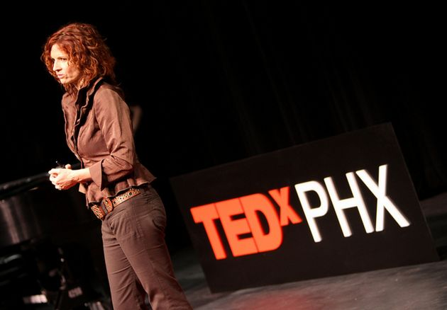 Poynter delivering a Tedx talk about her