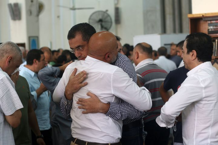 Relatives and friends of passengers of the EgyptAir plane that crashed in the Mediterranean, comfort each other during prayer