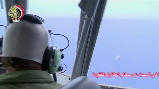 A pilot looks out of the cockpit during a search operation by Egyptian air and navy forces for the crashed...