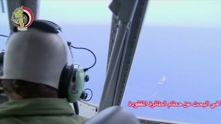A pilot looks out of the cockpit during a search operation by Egyptian air and navy forces for the crashed EgyptAir plane&nbs