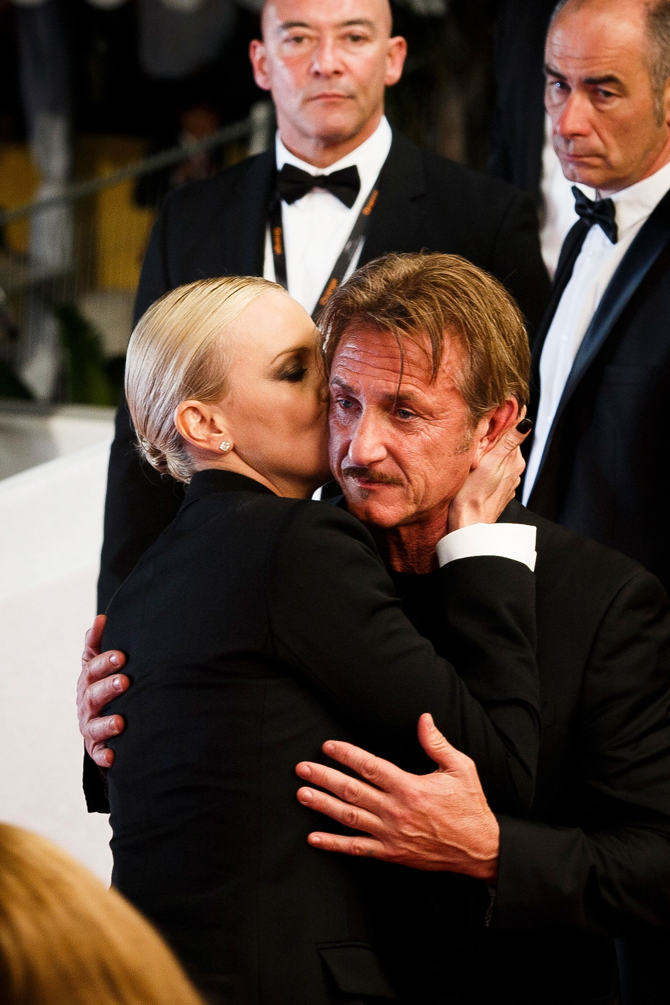 CANNES, FRANCE - MAY 20:  Sean Penn and Charlize Theron embrace each other as they leave the screening of 'The Last Face'  at the annual 69th Cannes Film Festival at Palais des Festivals on May 20, 2016 in Cannes, France.  (Photo by Tristan Fewings/Getty Images)