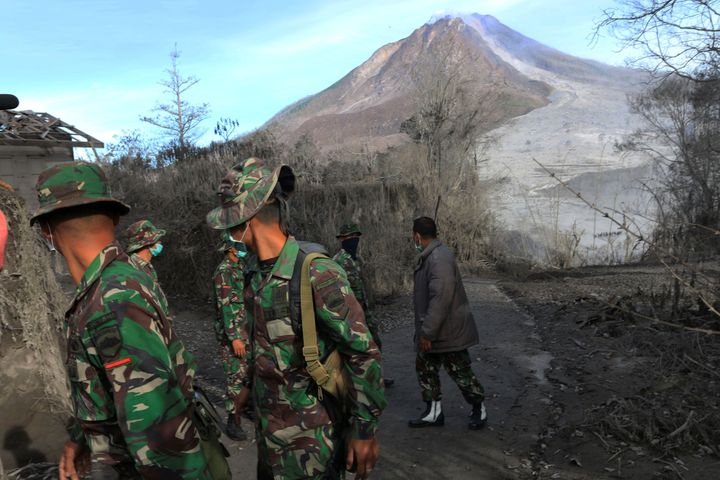 Indonesian soldiers search an area following a deadly eruption of Mount Sinabung volcano in Gamber Village, North Sumatra, In