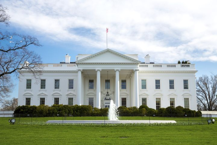 The White House reportedly underwent a brief lockdown Sunday after a pair of balloons landed on the property.