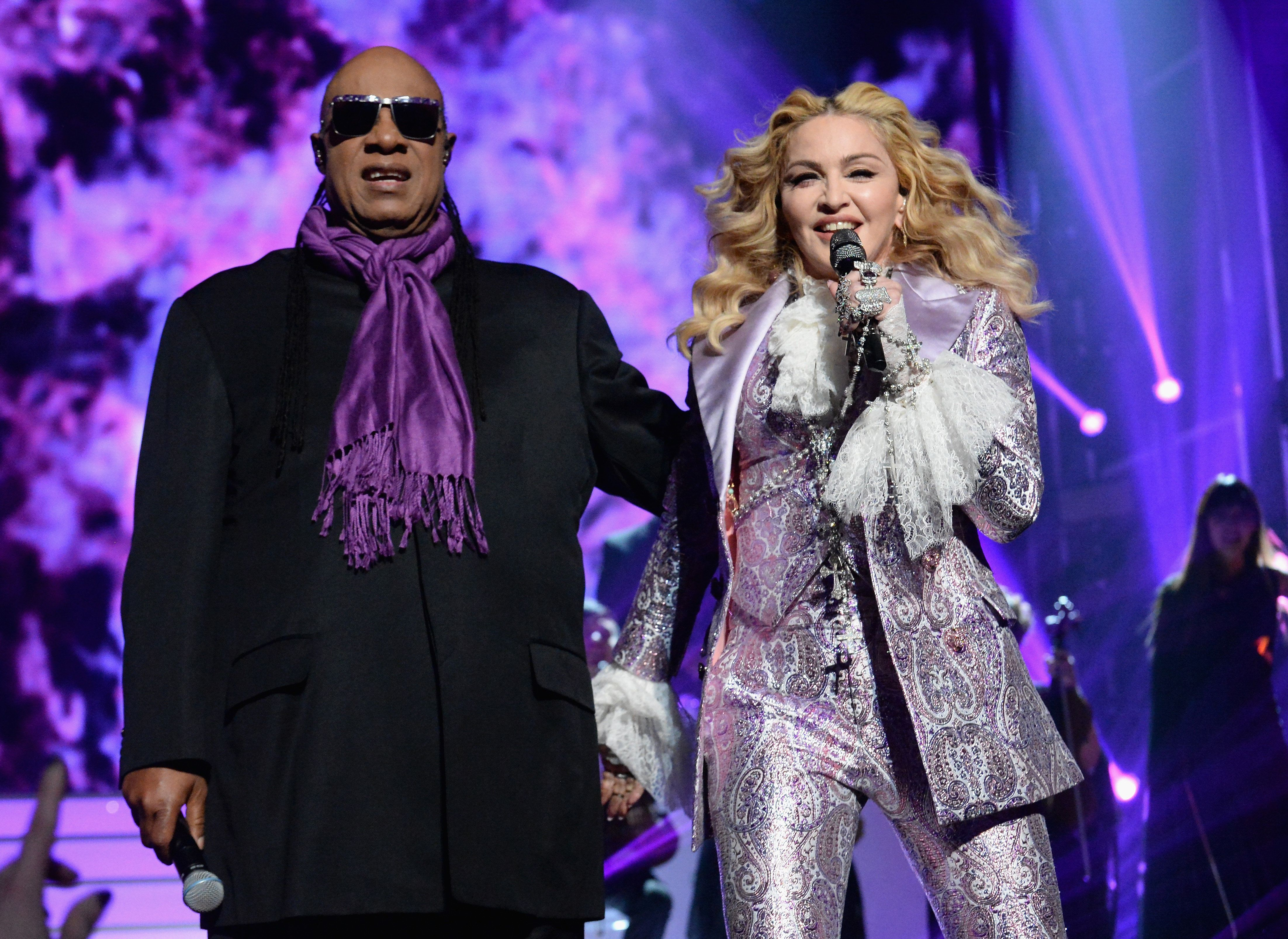 Stevie Wonder and Madonna perform a tribute to Prince onstage during the 2016 Billboard Music