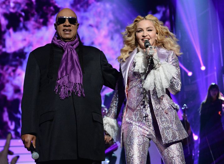Stevie Wonder and Madonna perform a tribute to Prince onstage during the 2016 Billboard Music Awards.