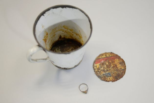 A gold ring was found hidden in the false bottom of a mug that was on display at the Auschwitz...