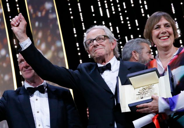 Director Ken Loach reacts next to producer Rebecca O'Brien (R) during the closing ceremony of the Cannes...