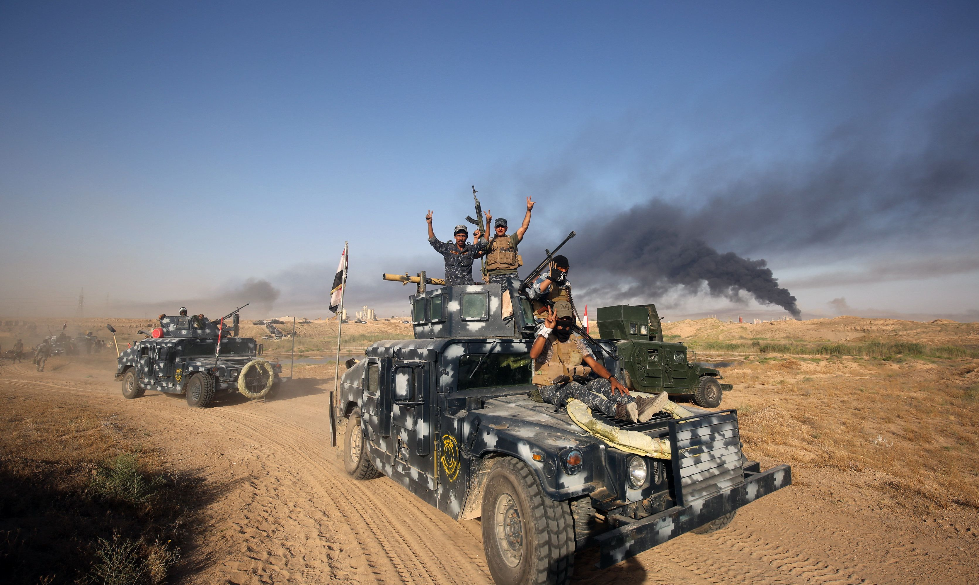 Iraqi pro-government forces advance towards the city of Falluja as part of a major assault to retake the city from ISIS.