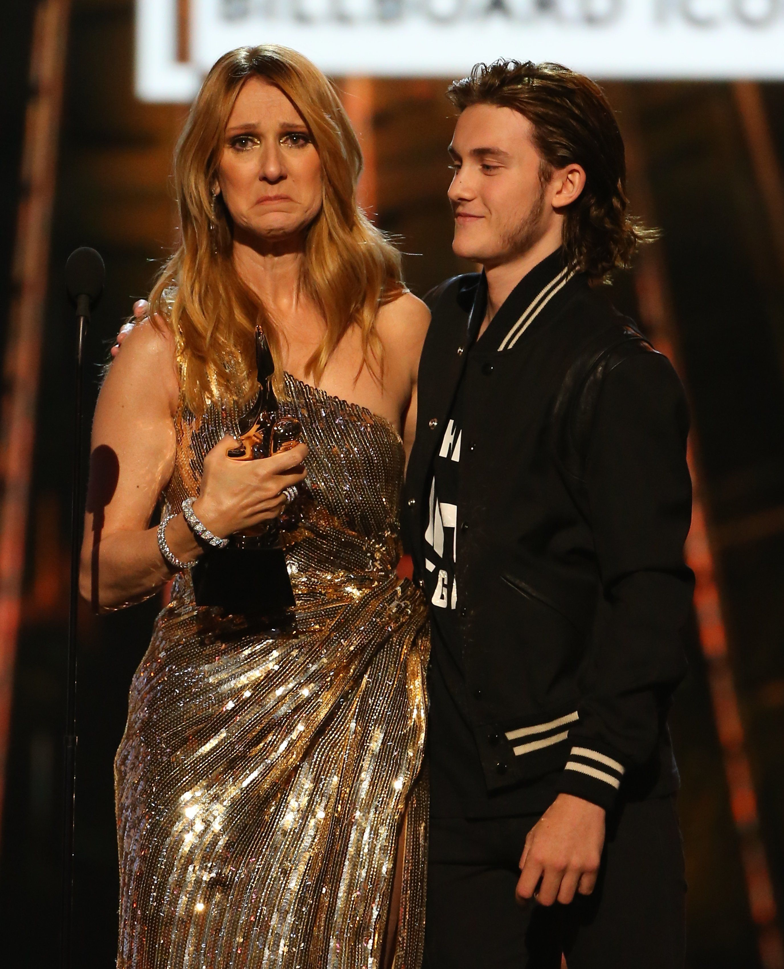 Celine was comforted on stage by her son as she broke down in accepting her Icon