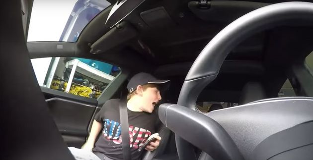 Dad Uses Tesla's 'Summon' Feature To Play The Perfect Prank On His Young