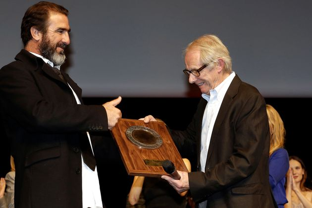 British film and television director Ken Loach, right, receives the Lumiere Award from the hands of former...