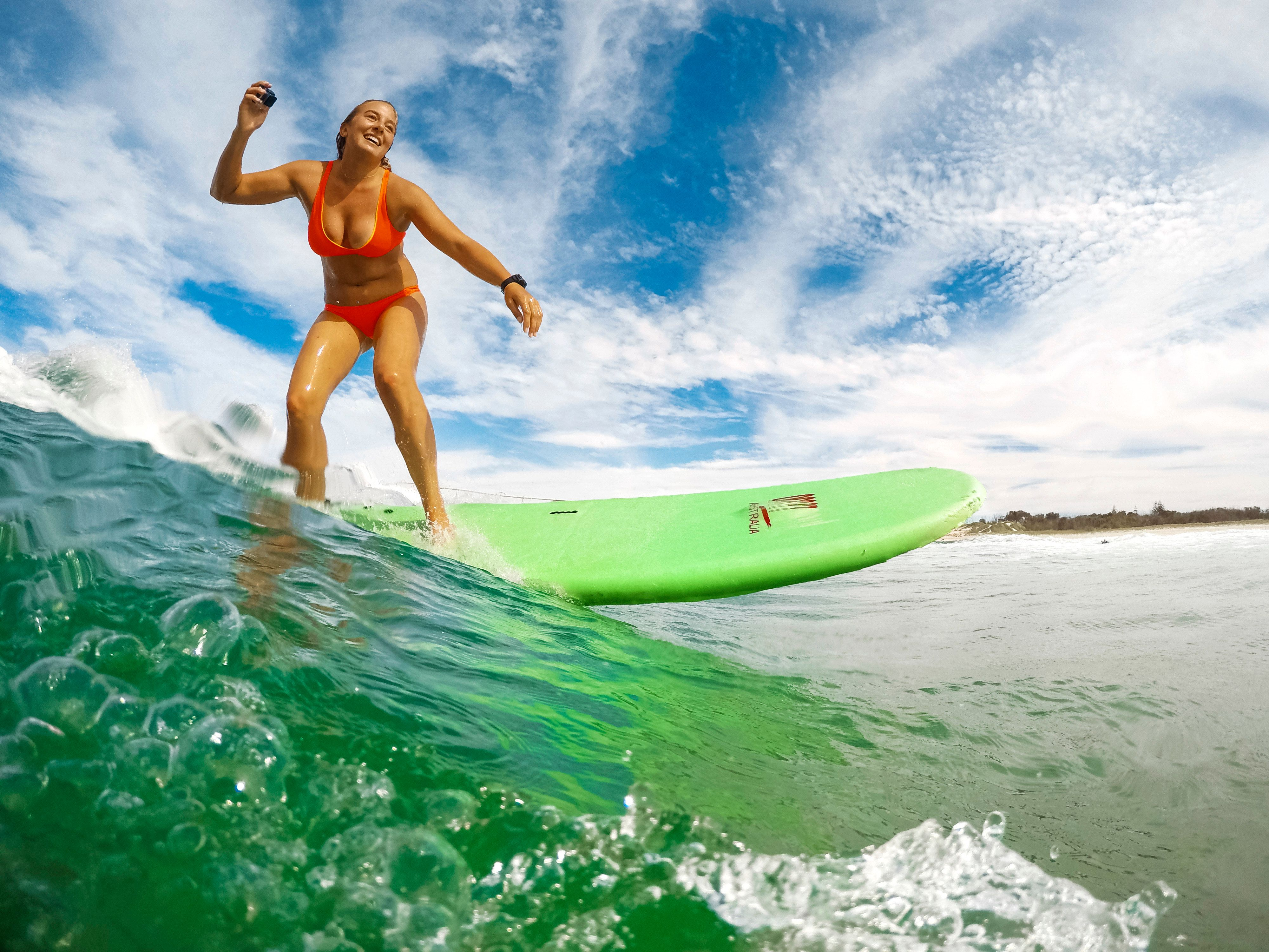 Professional standup paddler Izzi Gomez catches a wave in the Gold Coast,