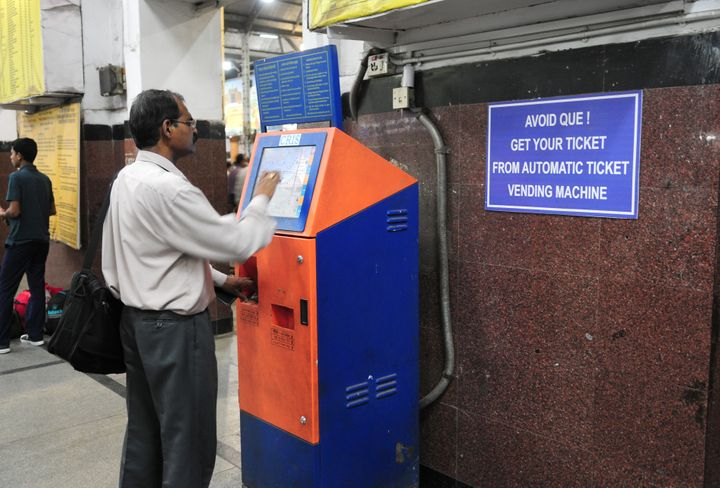 A passenger uses a touch-screen kiosk to buy a train ticket. The new child helpline kiosks will also be touch-screens in