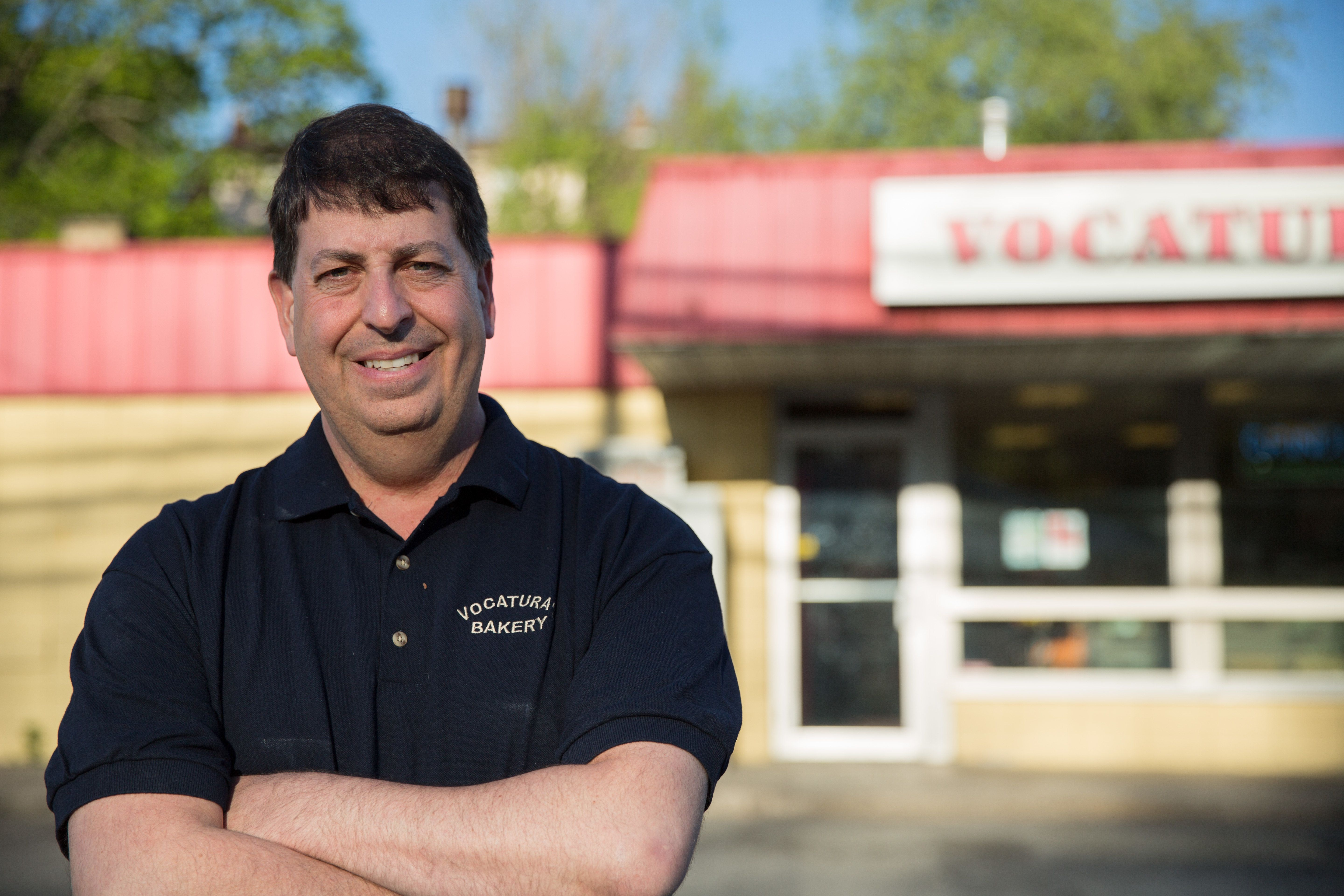 David Vocatura stands in front of his family business, Vocatura's Bakery. For over three years, he fought with the&